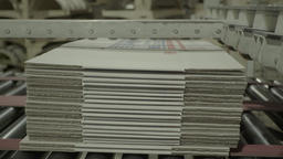 A stack of cardboard at the factory on the Assembly line Footage