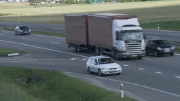 4K Ungraded: Red Truck With Trailer Drives on Intercity Highways Footage