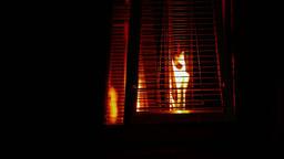 1080p Fire Burning Inside Contemporary Metallic Decorative Lamps in Dark Footage