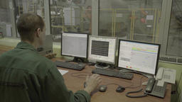Worker controls the production using computers Footage