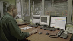 Male Manager in the control room at the plant Footage