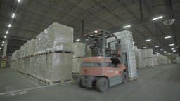 loader goes on to the large warehouse Footage