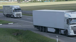 4K Ungraded: Four Trucks Drive on Intercity Highways Footage