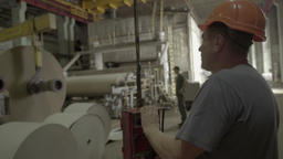 Worker works in a factory managing the production Footage