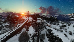 Aerial flight over Great wall of China at sunrise, snowing Footage