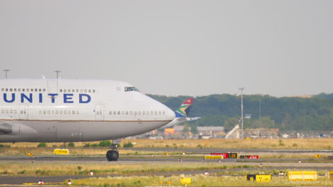 United Airlines Boeing 747 airliner gracefully taxiing to runway for departure Live Action