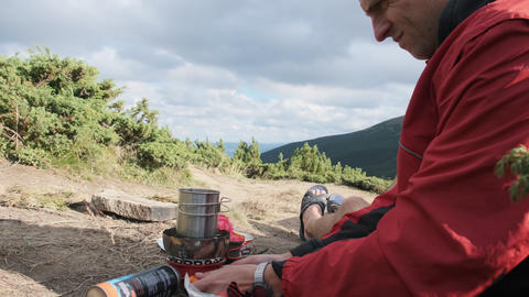Tourist Traveler in the Mountains, Preparing Tea on a Gas Stove. Solo Travel Live Action