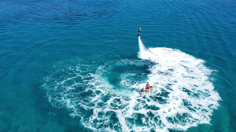 Fly boarding and sea riding in a sunny summer day, Zakynthos, Greece Live Action