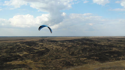 Gorgeous landscape along the seashore, paragliders flying, aerial view Live Action