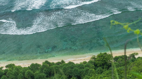 Top view perspective of waves rolling one by one to the nunggalan beach uluwatu bali indonesia 2 Live Action