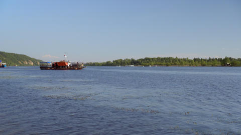 A ship transports a truck to the other side of the river. River View Live Action