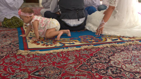 Baby Crawls on Fours on Carpet by Bride Long Wedding Dress Footage