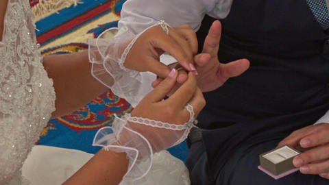 Bride Takes Ring Puts on Groom Finger on Carpet in Mosque Footage