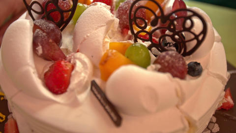 Closeup White Wedding Cake with Chocolate Heart Symbols ビデオ