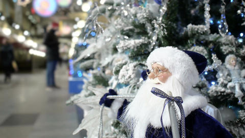 New Year's and Christmas tree decoration with Santa Claus in shopping mall Footage