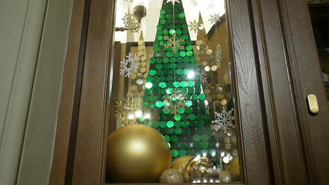 New Year's and Christmas decorations in window. Gold balls Footage
