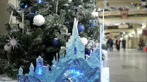 New Year's and Christmas tree decoration in shopping mall whith ice castle Footage