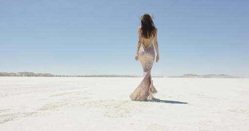 Girl walking in the desert Footage