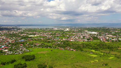 Tacloban, aerial view. Town and sky with cumulus clouds. Asian town by the sea Live Action