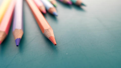 Close up of colorful pencils on color background Live Action