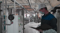 Worker checks the performance of the devices, the operation of the equipment and writes data Live Action