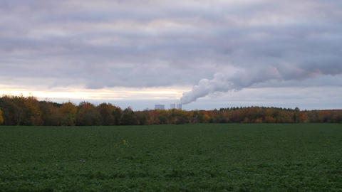 A coal powered steam power plant in Germany during sunset Live Action