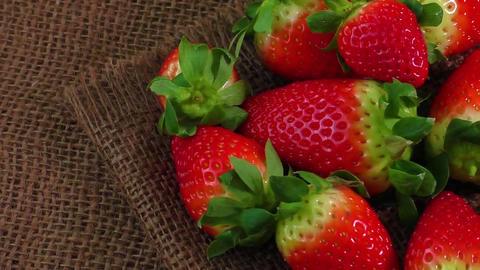 Close up fresh strawberry on burlap background Footage