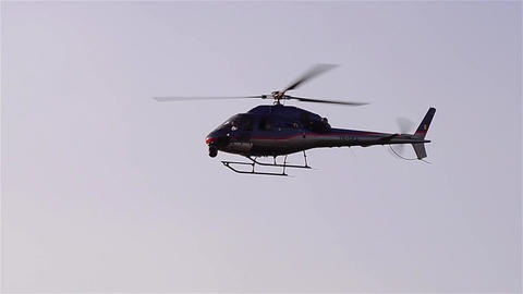 Helicopter flying at low height above the ground 04 Footage