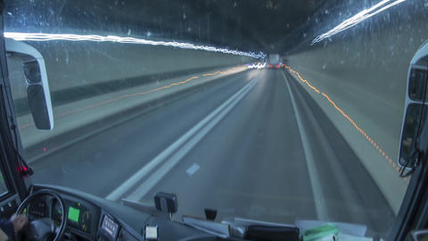 Timelapse with a bus crossing a road tunnel under a mountain behind a truck 28k Footage