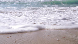 Gentle waves rolling to a sandy beach, half speed Footage