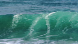 Phantastic waves rolling along with good wind, slow mo Footage