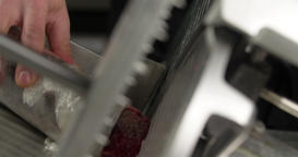 Chef hand cutting raw meat on slice machine 4k сlose up video for carpaccio Footage