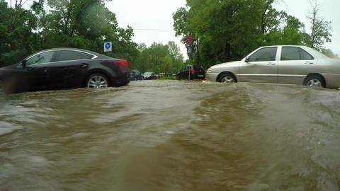 Cars Struggle To Proceed In Flooded Road Live Action