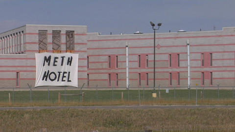 "A sign that says Meth Hotel"" hangs on the outside of a prison Footage"