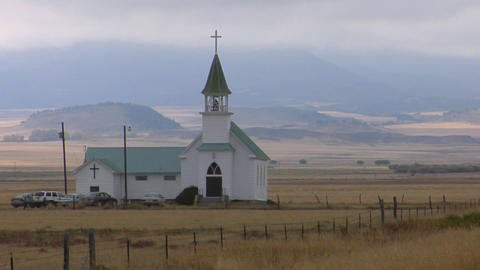 A small church stands on a Montana prairie Stock Video Footage