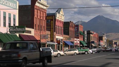 People walk along a street in a quaint Western town Footage
