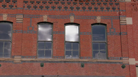 Windows and colored patterned bricks on a building Stock Video Footage