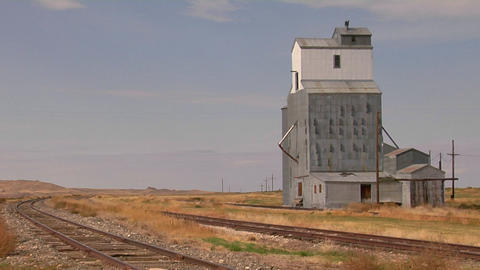 An abandoned grain elevator stands along a stretch of... Stock Video Footage