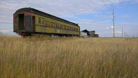 An old abandoned Pullman railway car sits in a field on a... Stock Video Footage
