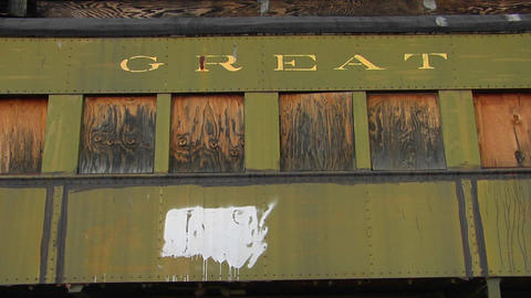 "A railway car that has Great Northern"" painted on it stands alone with boarded windows Footage"