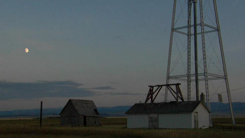 A water tower stands in a small prairie town Footage