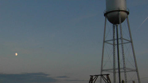 A water tower stands in a small prairie town Stock Video Footage
