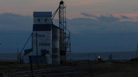 A train approaches a grain elevator Footage