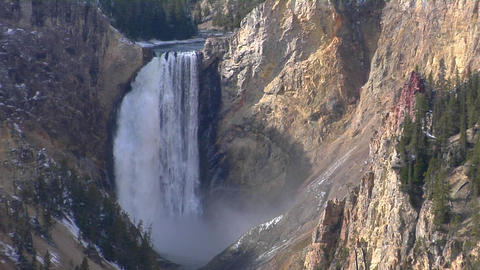 A waterfall cascades down the Grand Canyon of Yellowstone National Park Footage