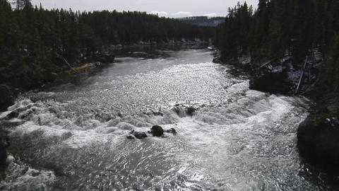 A broad river flows through Yellowstone National Park Footage