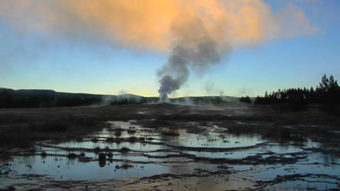 A geyser sends steam into the sky at Yellowstone National Park Footage