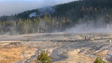 Tourists walk through a geothermal area at Yellowstone National Park Footage