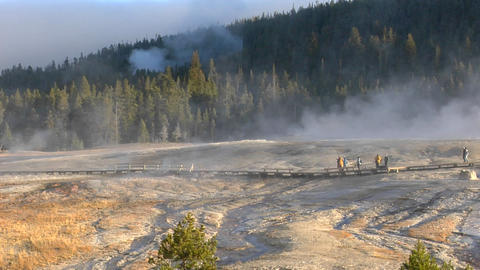 Tourists walk through a geothermal area at Yellowstone... Stock Video Footage