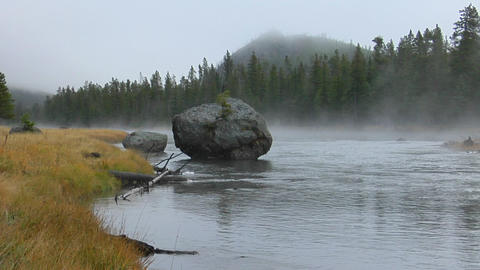 Steam rises from a geothermal river on a foggy morning in... Stock Video Footage