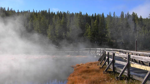Steam rises from a geothermal pool in Yellowstone National Park Footage